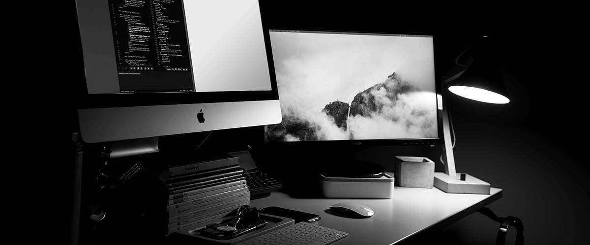 Bespoke vs enterprise computer screens on a desk