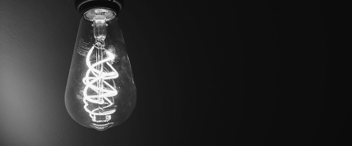 analytics to insight translation light bulb in dark room