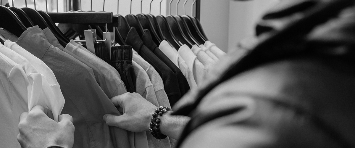 customer lifetime value man touching clothes on a rack
