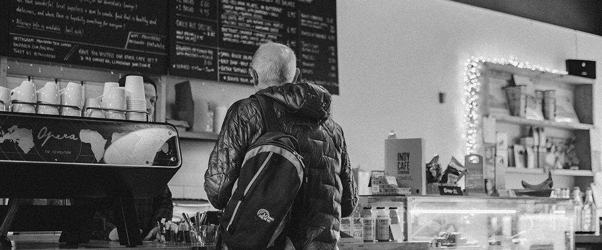 loyalty schemes man ordering coffee